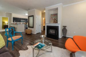 Living room with a gas log fireplace and blue chair