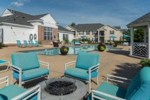 Blue chairs in front of a pool