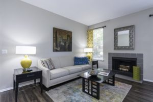 A white couch with blue pillows in a living room