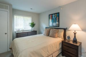 Bedroom with brown furniture and tan bet