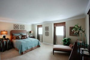 Bedroom with blue bed and brown curtains