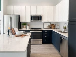 Open kitchen with white and black cabinetry
