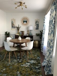 A table and 4 chairs in a dining room