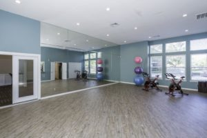 Large yoga room with bikes in the corner