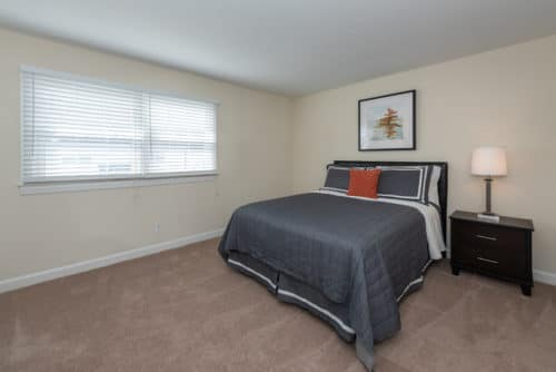 blue bedspread in guest room at walkers chase townhomes